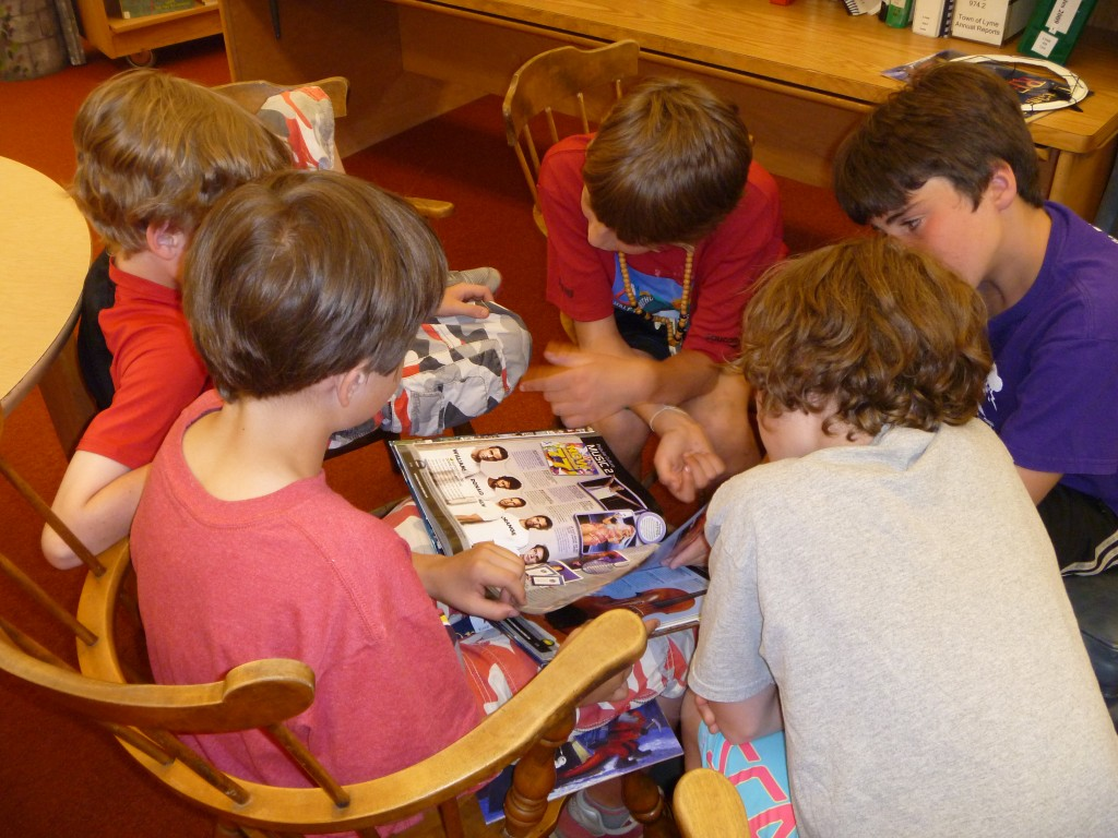 Group of boys looking at book